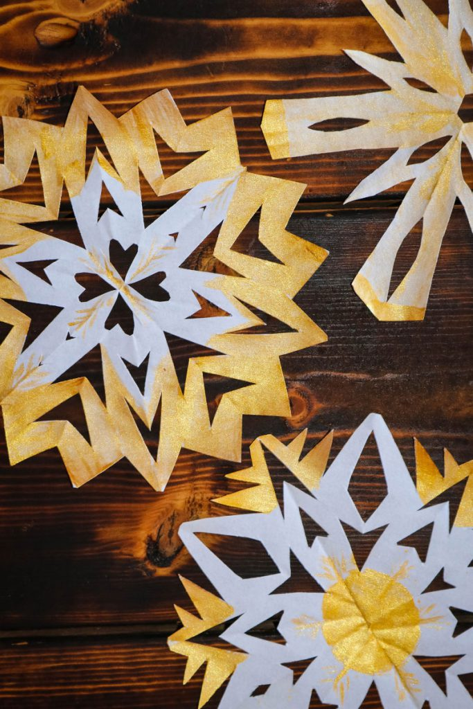 Paper Snowflakes painted with metallic paint.