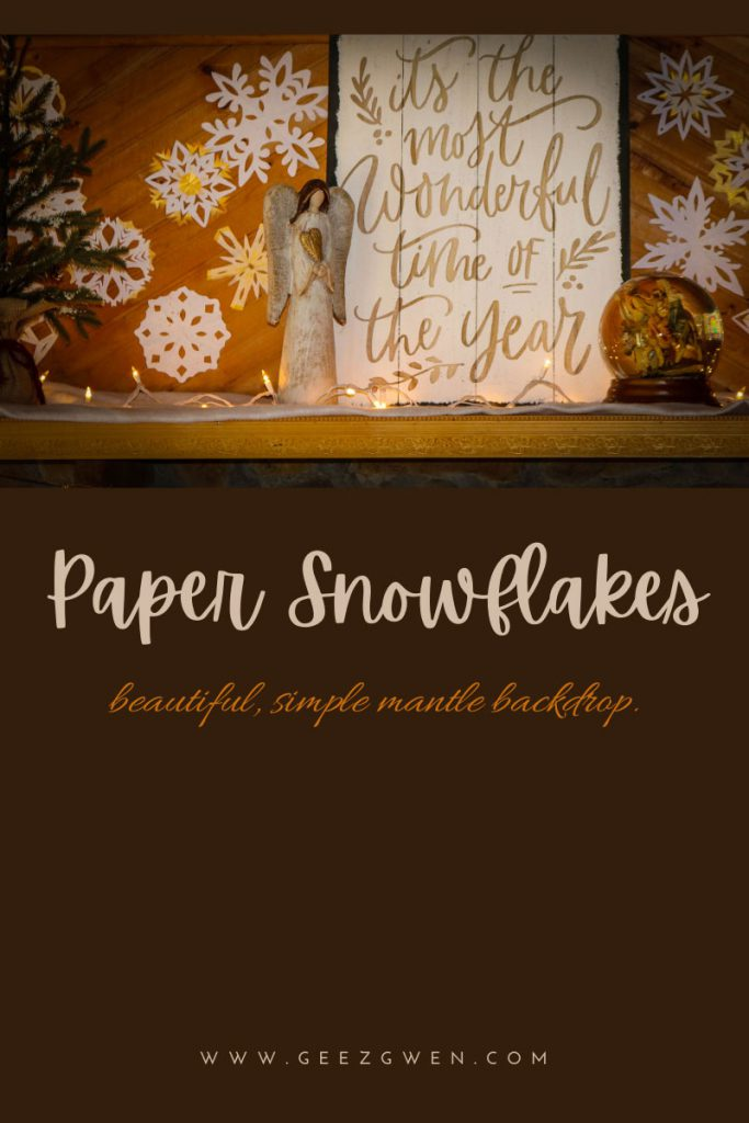 Golden painted paper snowflakes