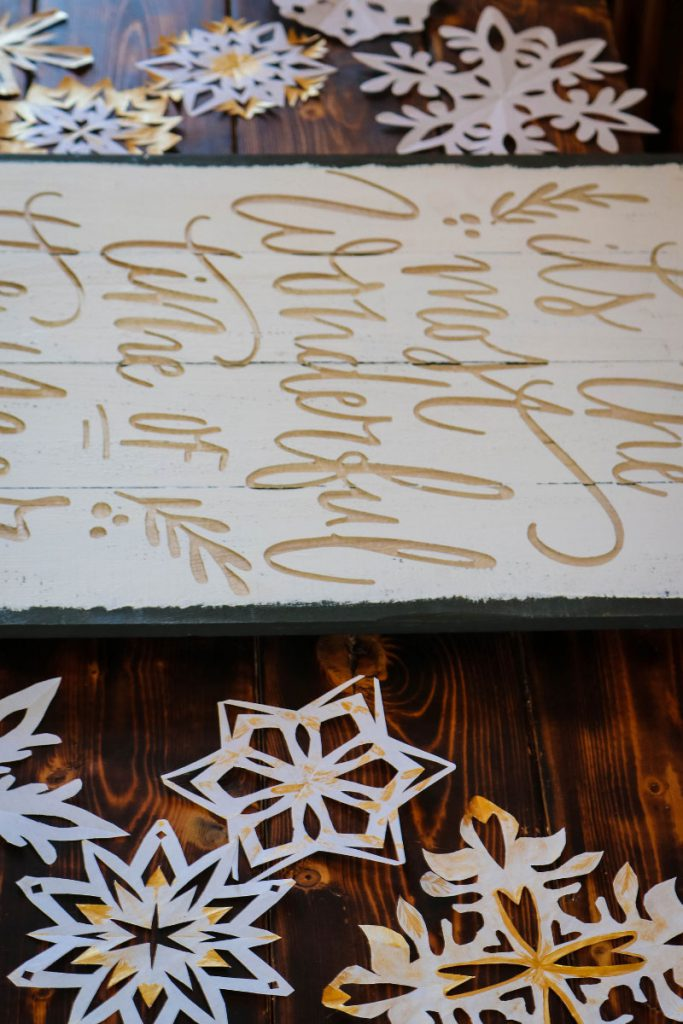 Paper Snowflakes painted with metallic gold paint for Christmas decor.
